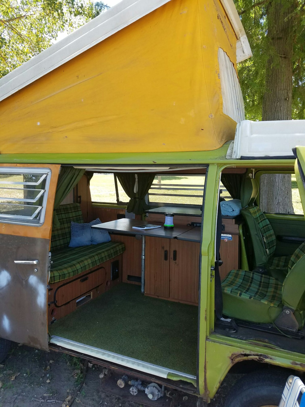 Fold up the sofa bed and put up the table! & The Rustic Hippie Van Camping with Kayaks! - Campers/RVs for Rent ...