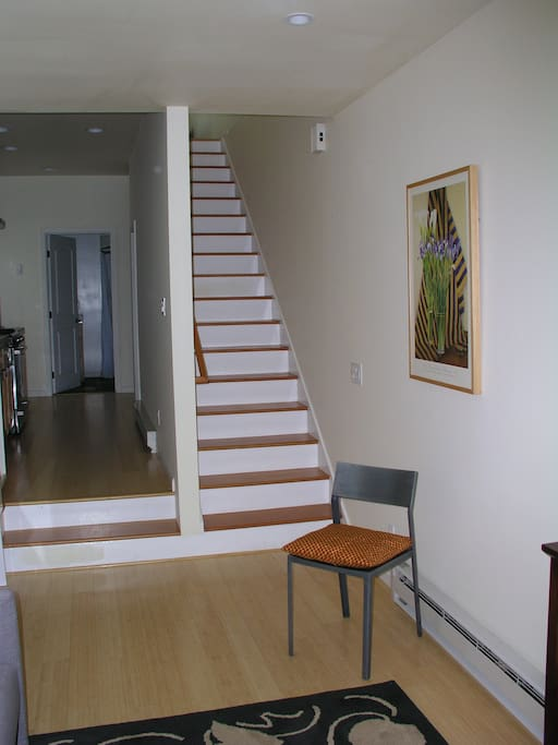 Stairs lead to bedroom