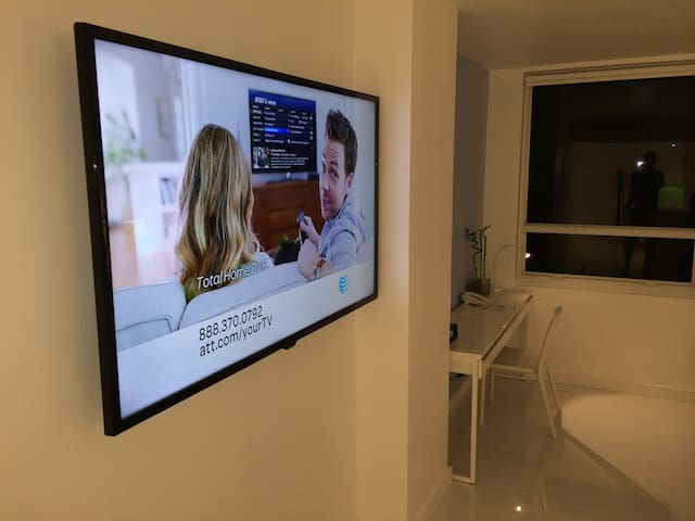 65 inch Samsung LED TV wall mounted with HD programing