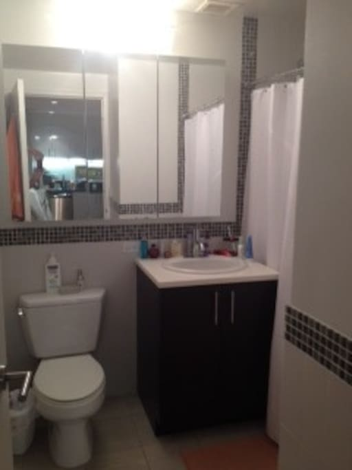 Spacious and modern bathroom with full bath and shower. All new appliances.