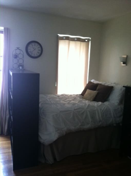 Full size bed and additional queen air mattress to comfortably sleep 4.