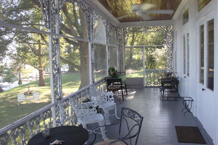 Elegant screened porch overlooking lake