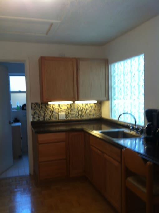 Kitchenette has dishes, microwave and double coffee pot