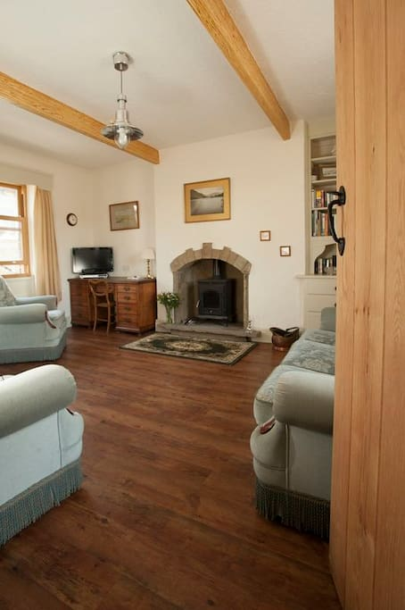 The spacious well furnished lounge with the wood-burner will help make your stay at Chapel View cottage a cosy one.