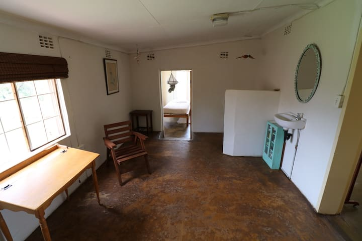 Sitting room leading to single bedroom and shower