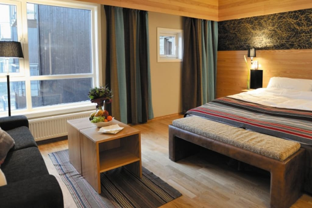 Cozy room with comfortable bed and sofa bed ideal for a couple or family