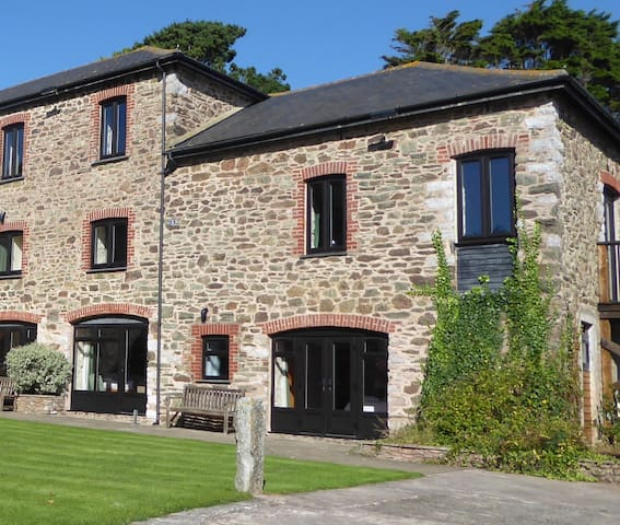 The Mylen cottage which comprises of 3 double bedrooms on the ground floor, a large lounge and kitchen on the first floor and a gallery above with a fourth bedroom