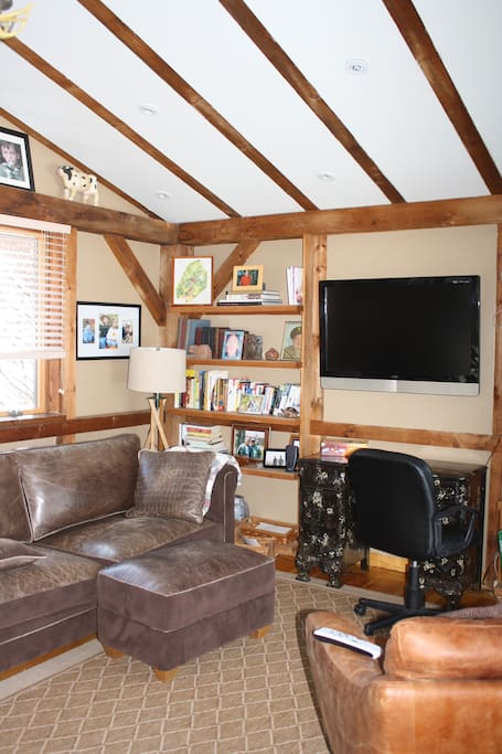 Cozy den with large screen satellite television and Wi-Fi access throughout the house.