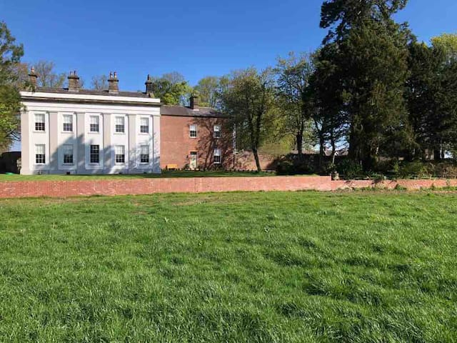 View from field in front of the house
