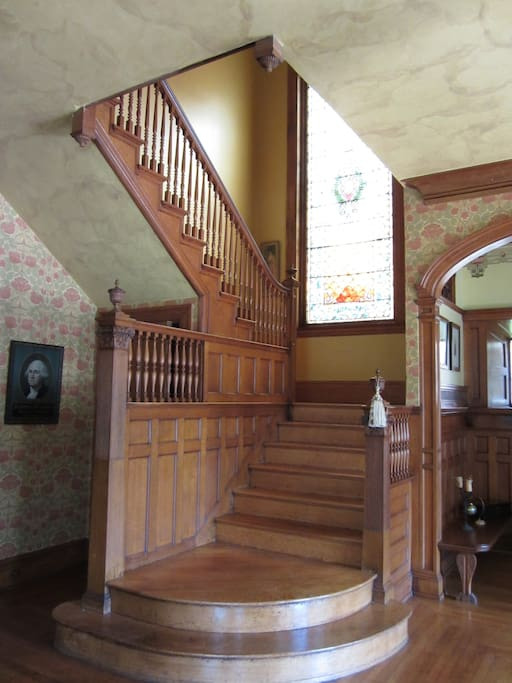 Grand front stair and 14 foot stained glass window