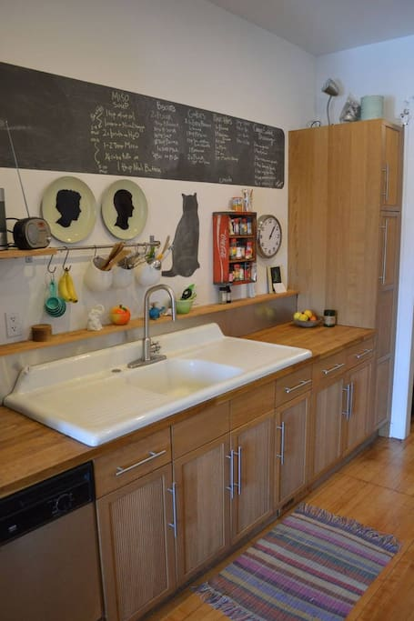 Our salvaged farmhouse sink and butcher block countertops.