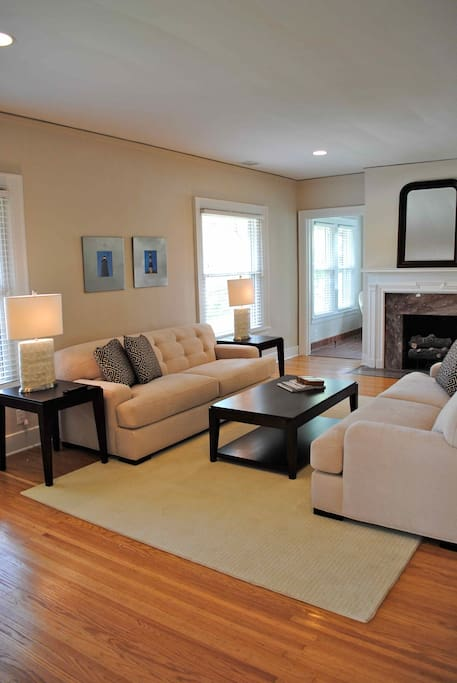 Living room with large flat screen television and fireplace