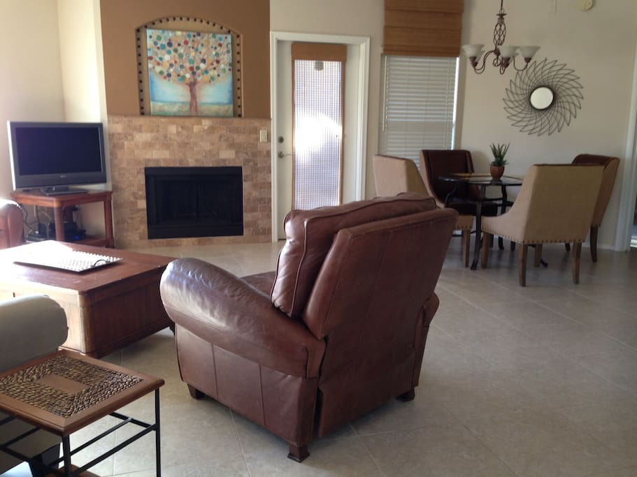 supple leather recliners and flat screen TV