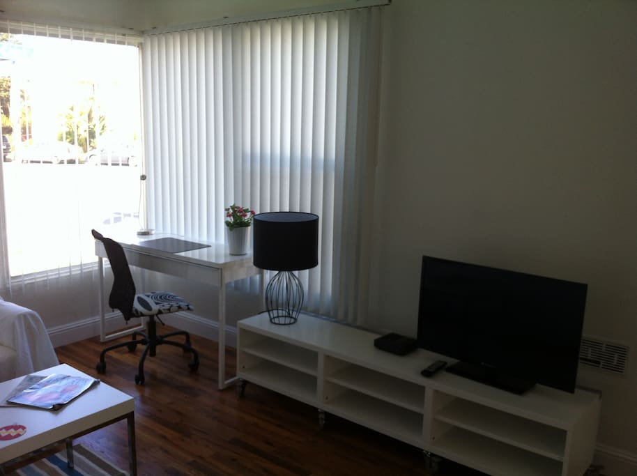 Light living area with desk in case you need to complete your work.  Wifi ready! You'll love it!