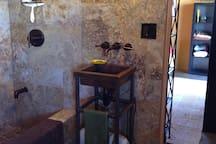 Bathroom - Travertine stone tub/shower. Copper sink.