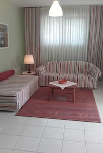 Garden apartment near airport and port. - Artemis