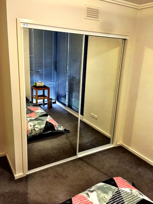 Built in Wardrobe with floor to ceiling mirror.