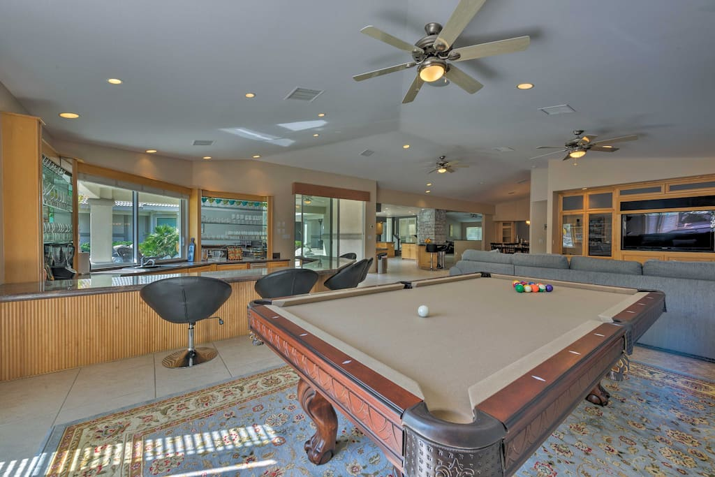 Step inside the family game room and bar area.