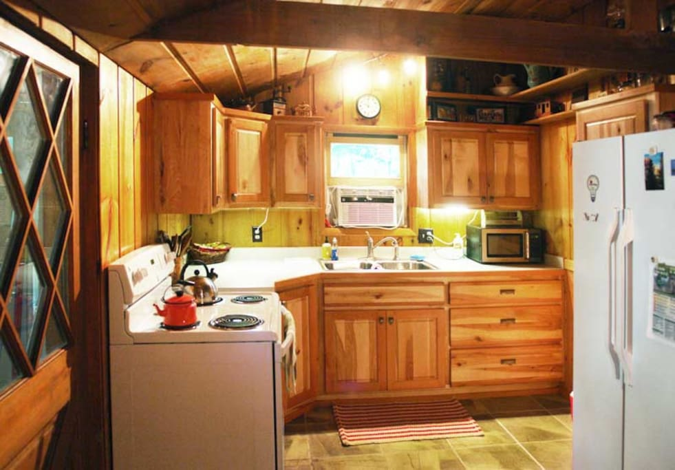 Newly renovated, equipped kitchen, spacious cherry & birch cabinetry, AC.