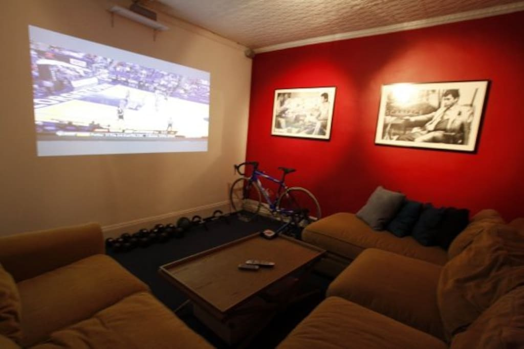 screening room with projector, surround sound and pull out queen sofa