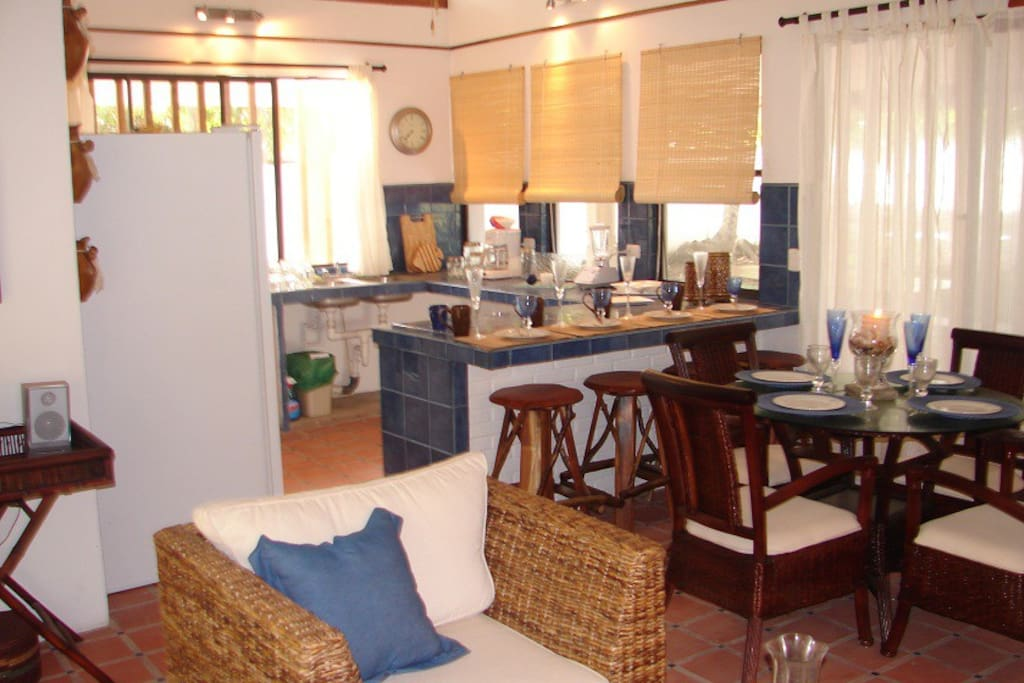 Kitchen and dining area for 7 people.  There's a large picnic table on the veranda for dining as well.