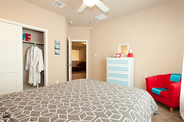 This room comes with 2 dressers, an arm chair and roomy closet.