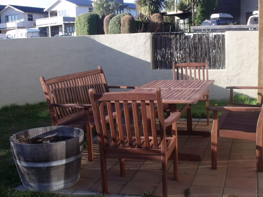 Private outdoor area that is great for sun lovers and those who like eating outdoors.  The barbecue and sun umbrella are great additions for you perfect holiday experience.