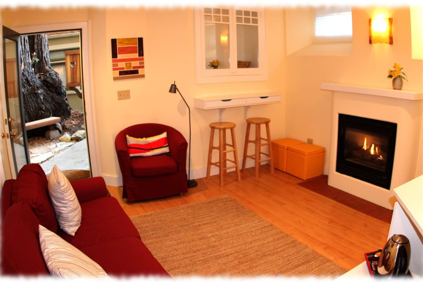 Front room with fireplace and kitchenette
