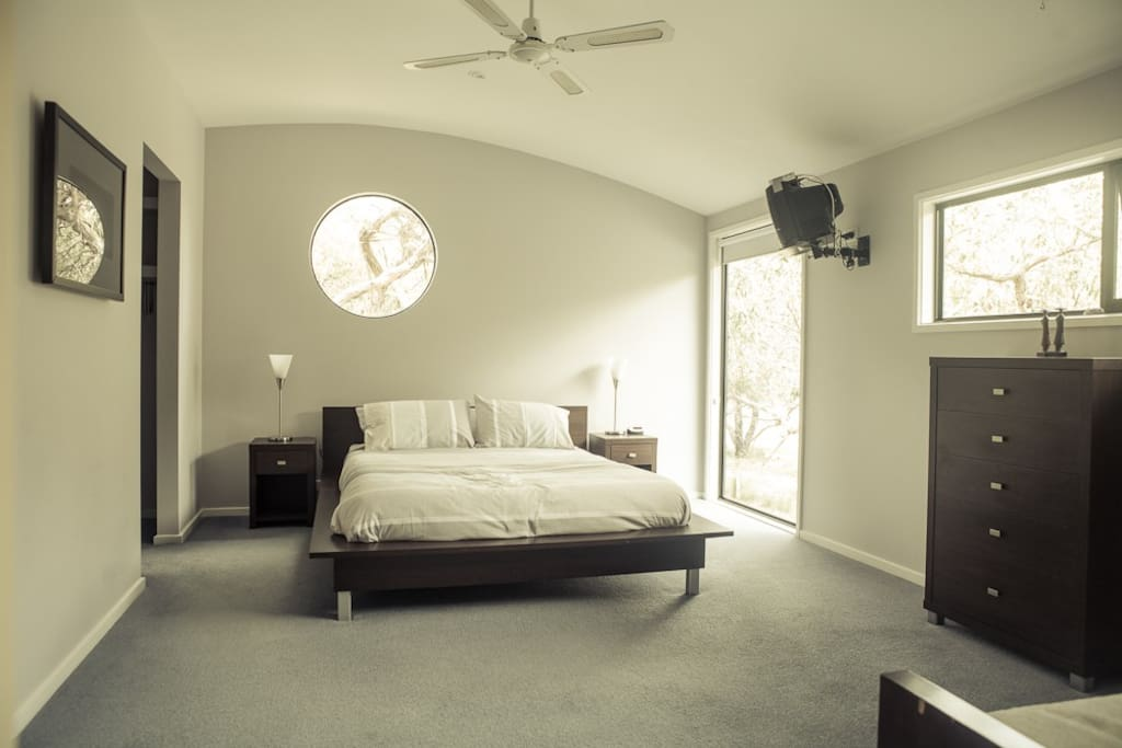 The master bedroom upstairs with walk-in closet and en suite.