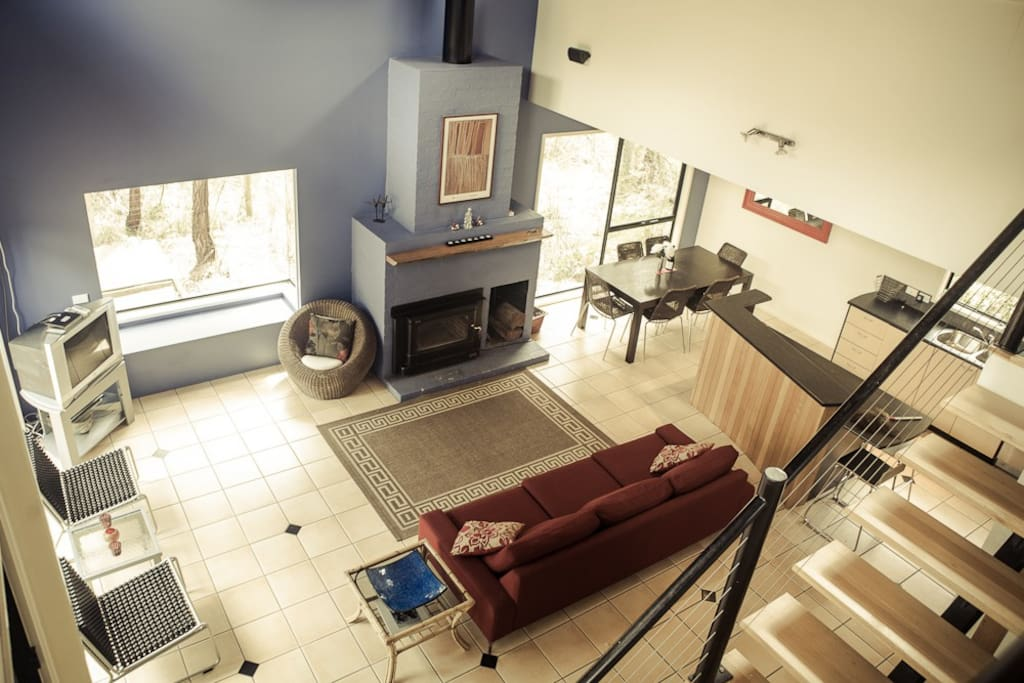 The living area, photographed from the top of the staircase. The kitchen (not pictured) is to the right of this area.