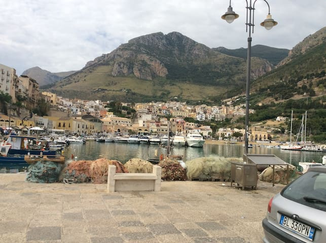 The charming port with bars,restaurants e cafes.5 minutes from apartment