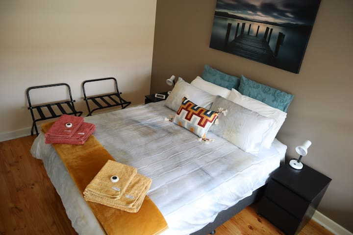 Master bedroom for a comfortable night's sleep. There is ample space in the built in wardrobe. 2 suitcase stands are provided.
