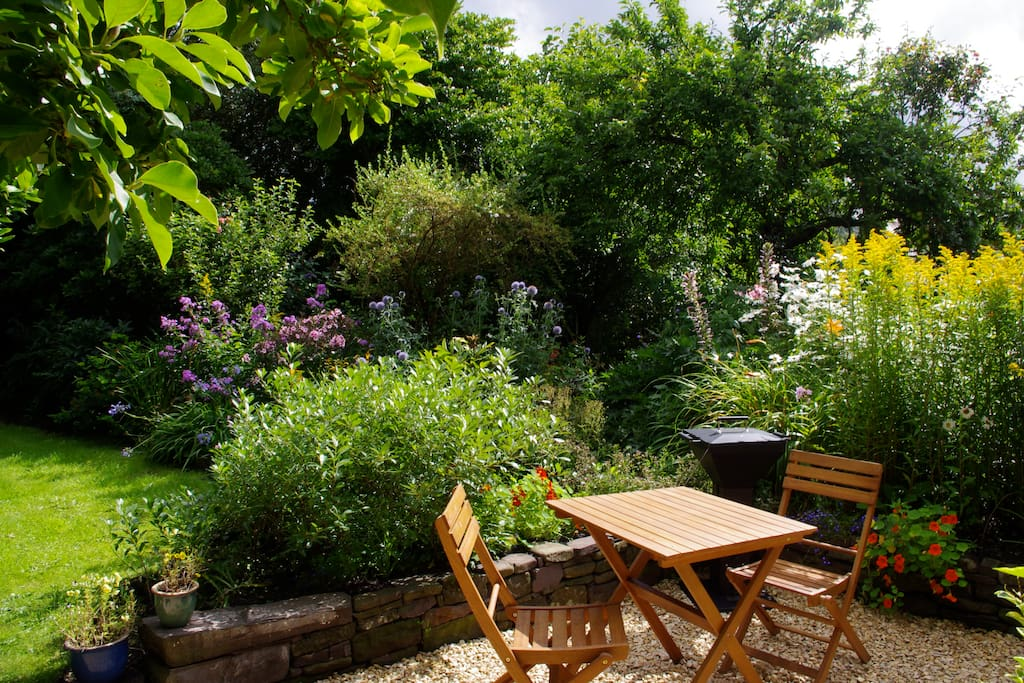 The pretty garden with a barbecue