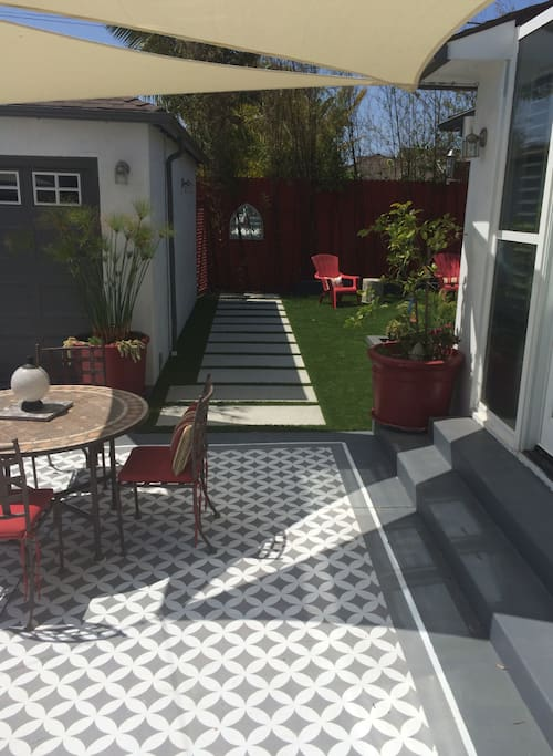 Backyard includes multiple seating areas
