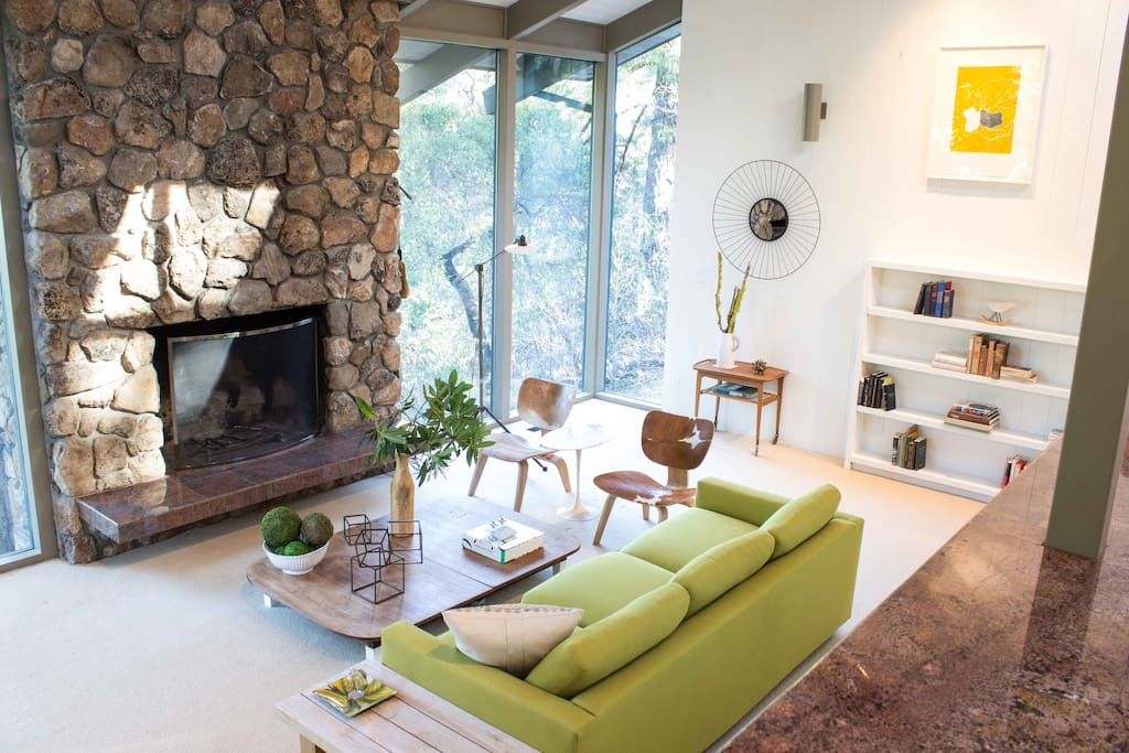 Living Room with wood burning fireplace, ceiling to floor windows, expansive light and exceptional views.