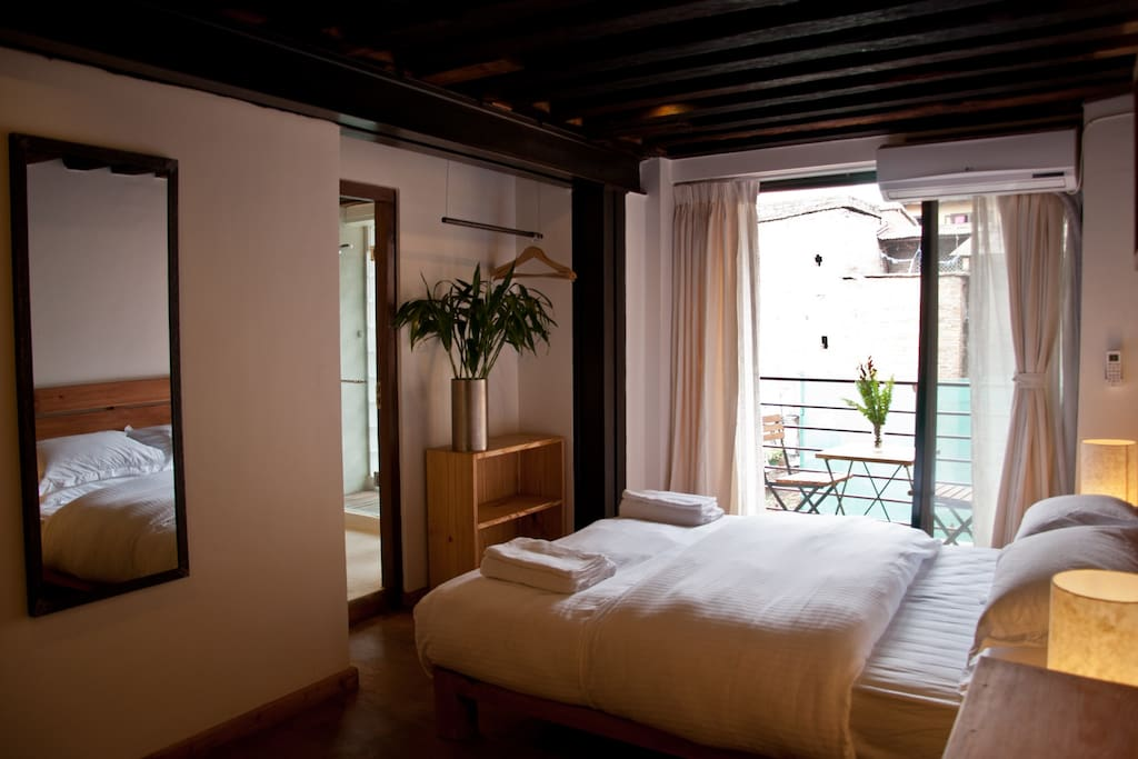 Queen Size bed & small balcony to view inner courtyard.