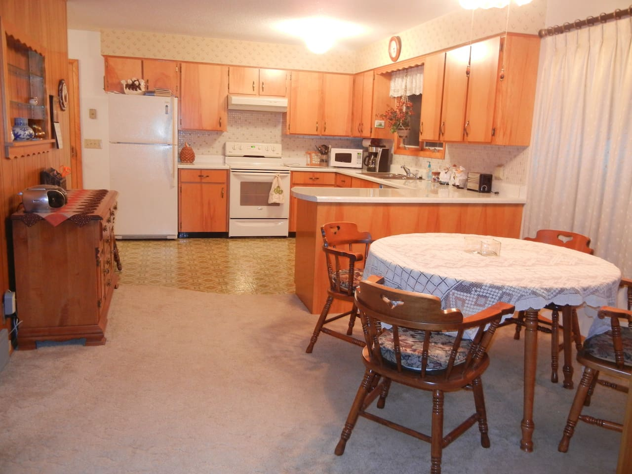 Kitchen and dining areas of the property open to the living room allowing for great visiting opportunities as meals are prepared and served.