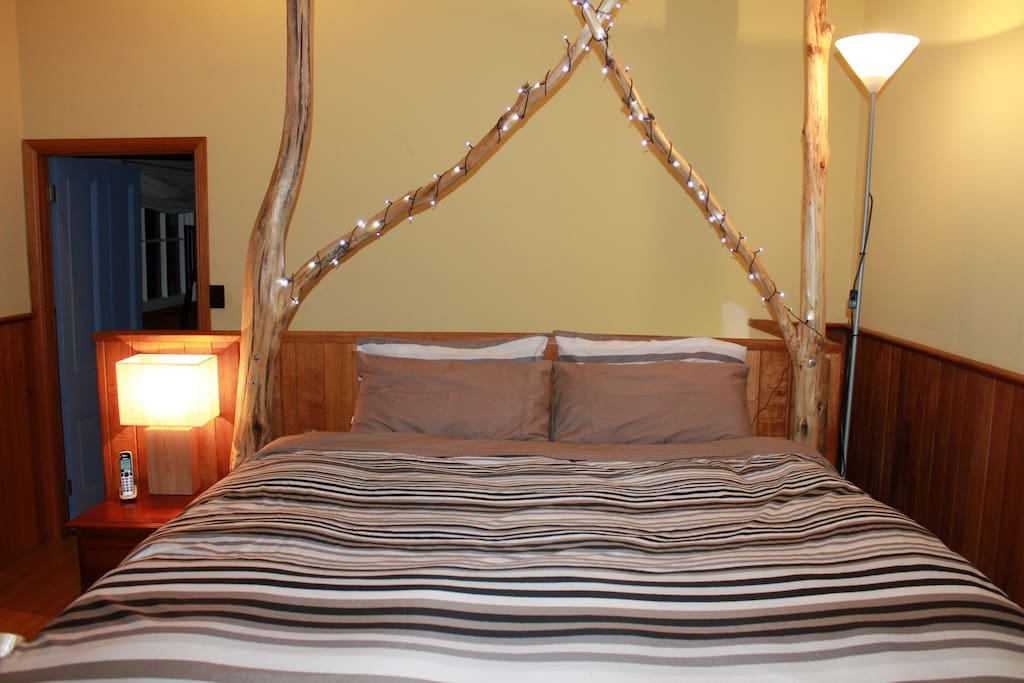 King size room, with a custom built blue gum bed.