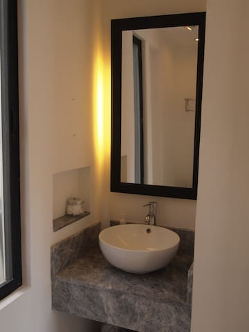 Sleek and modern private bathroom.