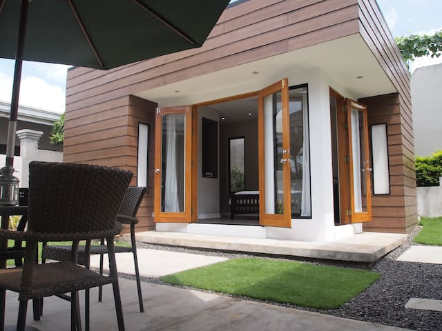 Enjoy your morning cup of coffee or glass of fresh fruit juice on the patio outside your door.