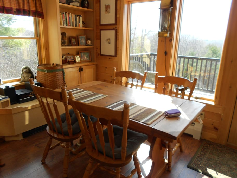 Dining Area with Deck. GORGEOUS VIEWS OF RIVER AND SURROUNDING HILLSIDE. LARGE TABLE WITH LINENS.