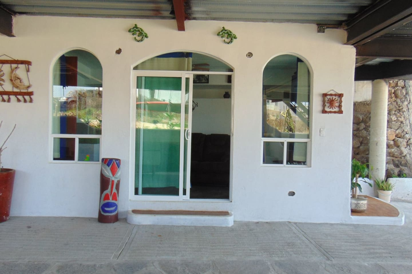 Front door opens to a patio area and ocean view