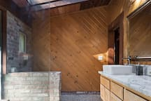 Skylight and natural river rock tile