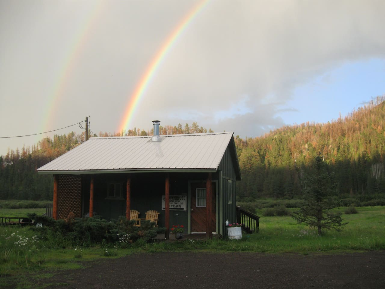 Pegnam's Bunkhouse...in the Greer village. Monsoons bring a double rainbow to this very special retreat.