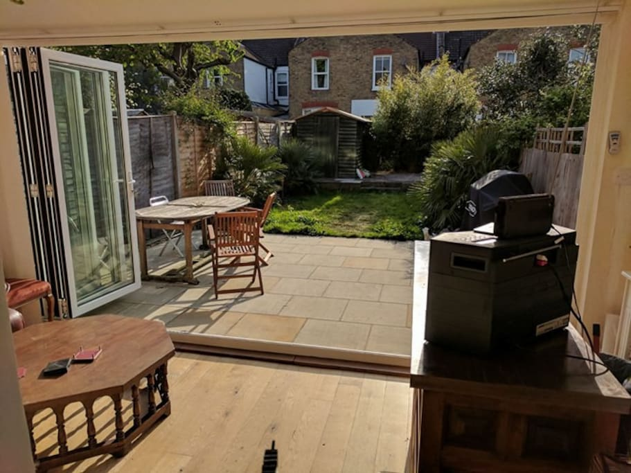 Sunny west facing garden which opens up from the lounge