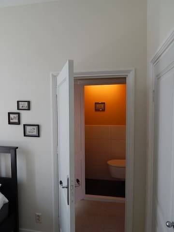 Looking from the rear bedroom towards the toilet.