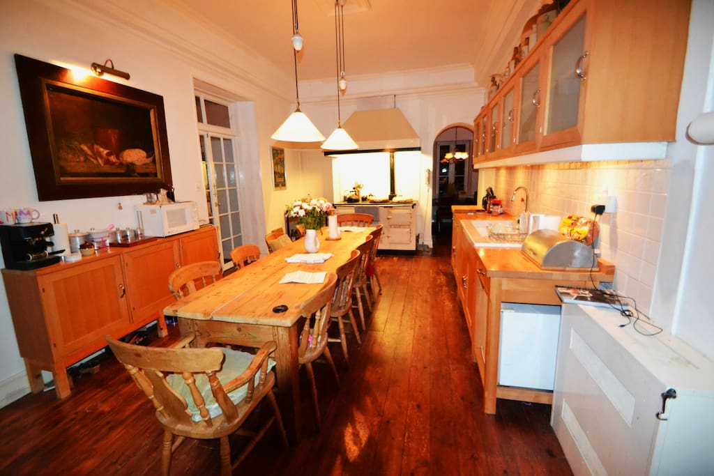 Kitchen - AGA at the end, dinning sit of 12 people.