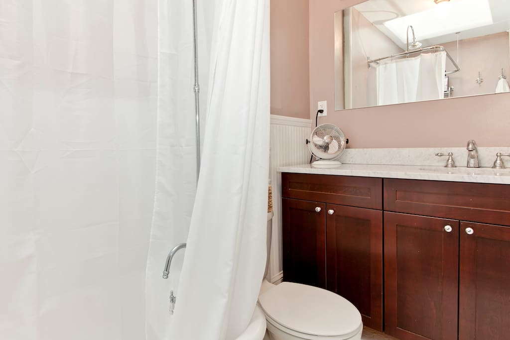 This is the bathroom dedicated for our guests.  It features an antique claw-foot tub with a shower and a large vanity.