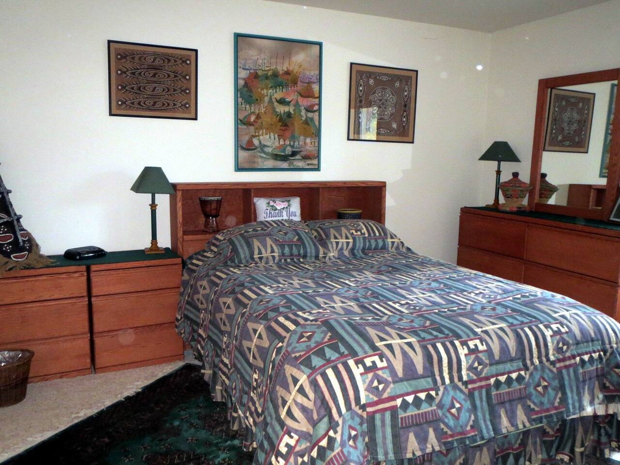 The Exotic Treasures Teal Room features a queen-sized bed. Located downstairs, it is the most private room.