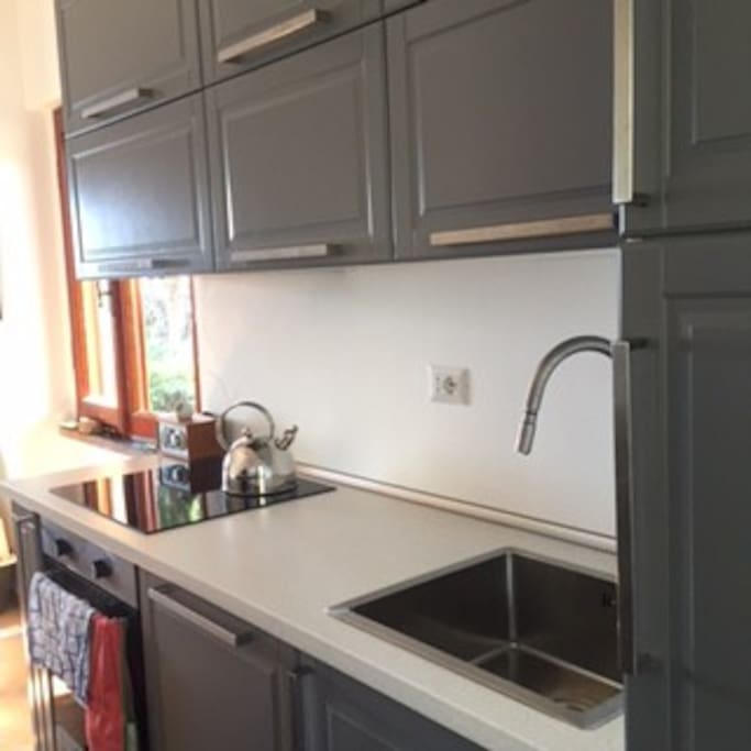 Brand new kitchen, with dishwasher and oven